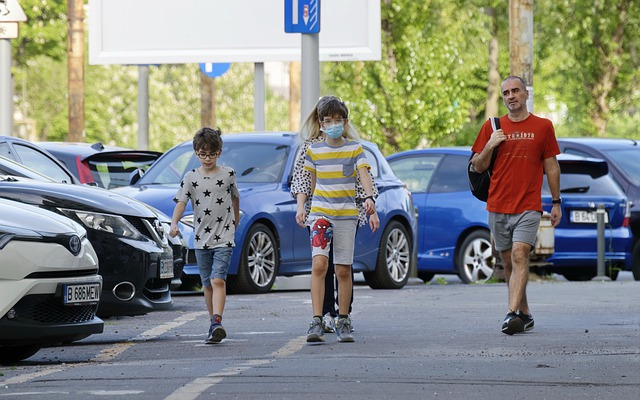 Children wearing masks while waking on road
