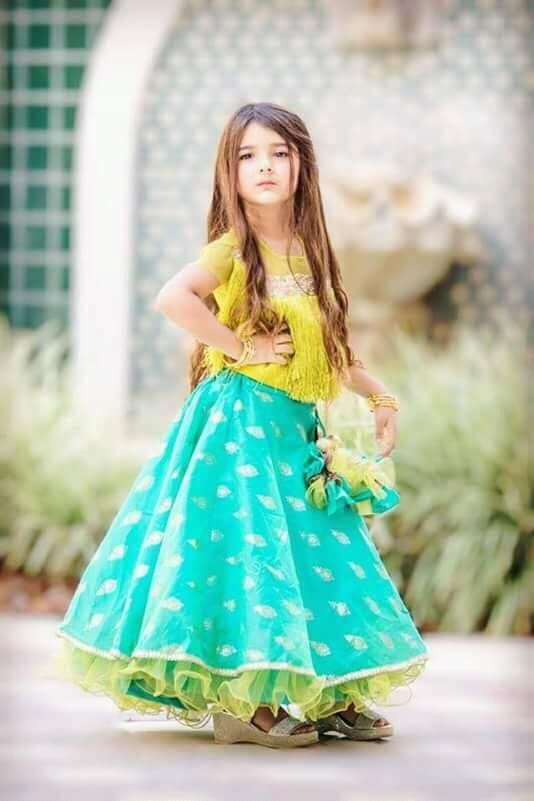 Traditional girlswear online - A girl posing in a beautriful partywear outfit