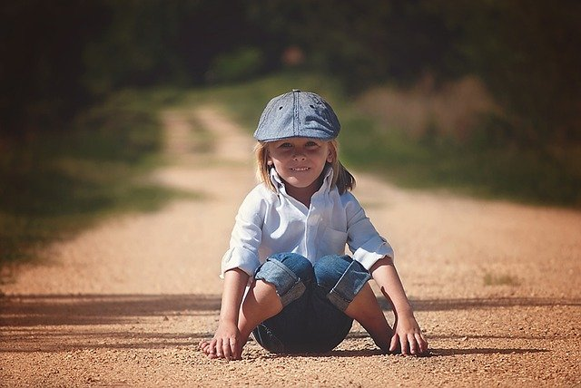 Kids wear online -A girl posing in white collared top and jeans