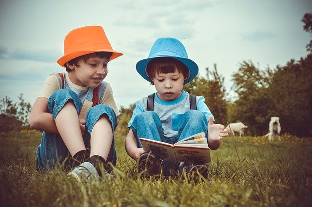 kids wear online - Children sitting in the farm wearing trendy outfit and hat