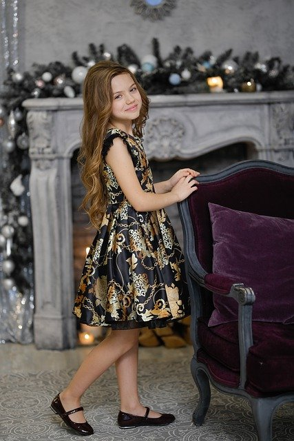 A dress brought from online store - A cute girl standing in a beautiful black coloured dress