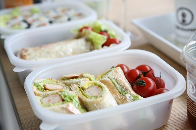 Lunch box filled with healthy food for school kids