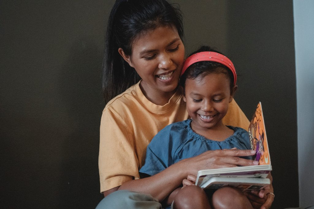 Mom teaching child at home - Essential for primary level kids