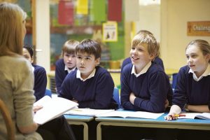 Primary schooling - A student listening to the teacher in class