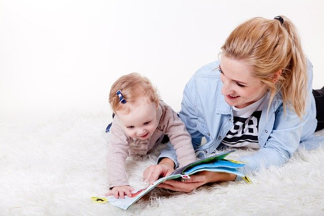 Story reading for kids - Mom pointing out a picture in a book for a little girl