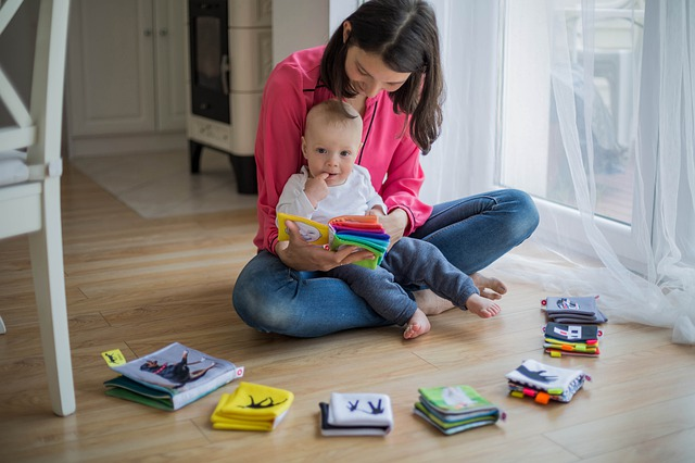 A mom reading variety of books for a toddler.