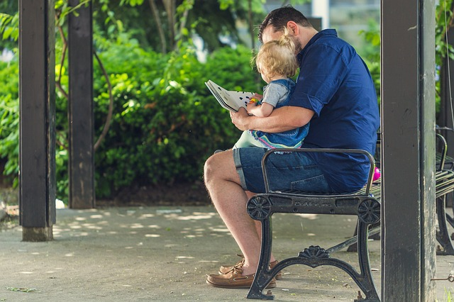 Story reading for kids - Father reading a book with a child