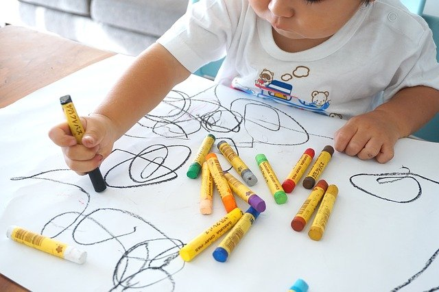 A kid involved in coloring - An activity for kids indoors